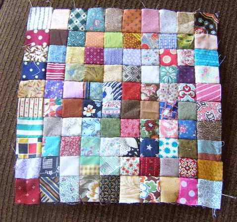 "100 hand stitched 1"" squares"