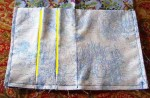 Open pleats and sew along fold line