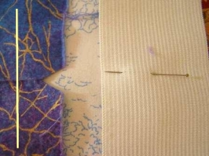 Notched Upper Edge and pinned elastic.