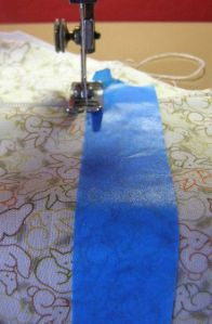 Using tape to keep sewing lines straight