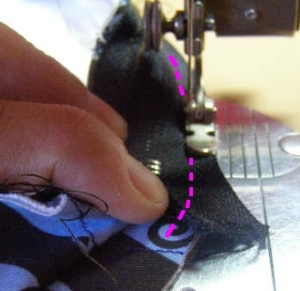 Sew across end of zipper tape
