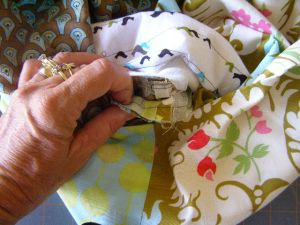 14.  Pull two base seams through base opening and align two sides seams.