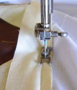 10.  Sew just outside the border seam- starting from center square point and sewing outward.