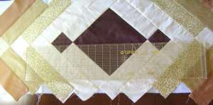 3.  After first strip, the squares are sewn to the next darker color rectangles.