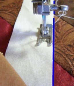 8. Using pressure foot to define seam allowance, align border edge with drawn line and sew through all layers.