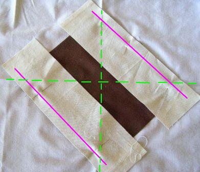 Sew along pink lines.  Green dotted lines are crease lines in foundation fabric.