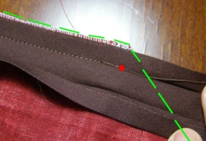 7.  End seam at red dot.