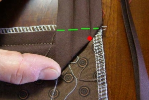 4.  Fold bias binding straight up to form a 45 degree angle.  Then fold down along green dotted line.