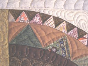 Detail of light colored fabric in outer arch