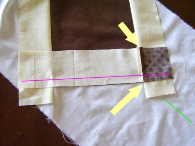 Place Strip A/ Square J as shown, aligning at arrows. Sew through all layers using pressure foot as seam allowance