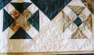 Monkey Wrench Squares and feathered quilted muslin - on the bias!