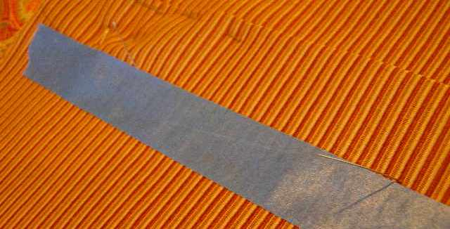 Lay a piece of tape along pins to define placket seam line.