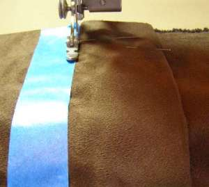 Sew along edge of tape to create an even, straight placket seam.