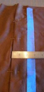 Tape should be a consistent distance from placket crease.