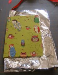 Foil placed inside covers, ready for heavy books to hold flat for drying.