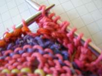 Lift Stitch 2 and pass over Stitch 1.