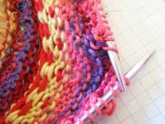 being lifted and ready to be knit together with Popcorn Stitch.