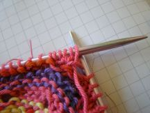 Turn work again (wrong side facing) and knit the five stitches.