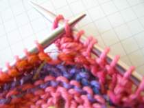 Lift Stitch 3 and pass it over Stitch 1.