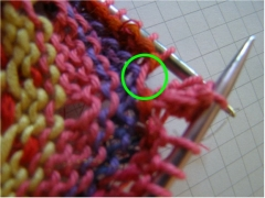 "This Stitch will be picked up and knit with ""popcorn stitch"" on next row to close hole."
