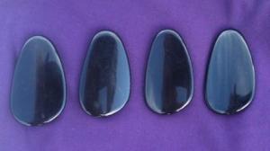 The black plastic lozenges.
