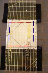Match seam lines (red) and paper piecing sewing lines (blue) to lines on ruler.