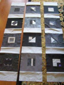 Squares sewn into vertical strips.