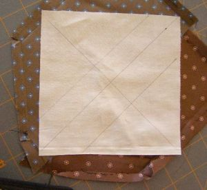 oundation Fabric square marked with HST cutting line and diagonal lines for piecing