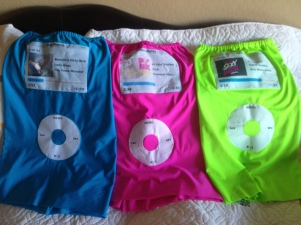 Ipod costumes in blue, pink and lime green.
