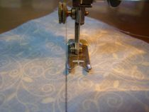 "Sew approximately 1/4"" from line - on each side of line."