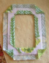 Photo 5.  Fusing fabric to frame.