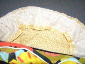 Side curved edge seams sewn