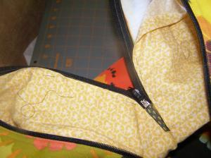 Pin folded edge of lining to Zipper.