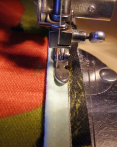 "Stitch piping by aligning raw edge to 1/4"" guideline stitching."