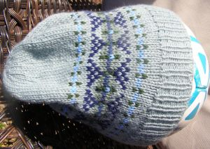 Slouch hat in greens and blues.