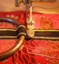 sew back and forth across narrow ribbon to secure rings.