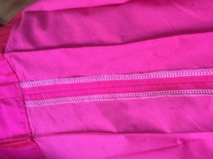Finished edges and top-stitched pleats